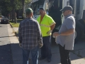 Sanitation worker talking with residents