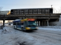 Metro Transit bus going under bridge in winter