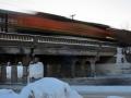 Train moving quickly on rail bridge