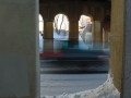 View from sidewalk through arches of bridge
