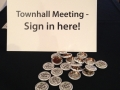 Townhall meeting sign-in poster with Logan Park buttons